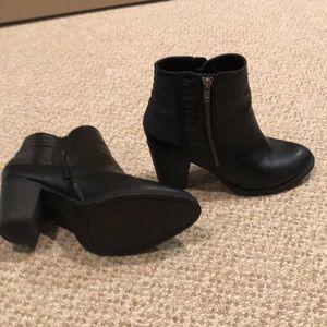 Black angle heeled boots